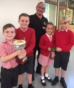 Presenting Swimarathon Cup to Elmwood school